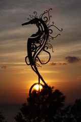 Fairhope Seahorse (michaelwr) Tags: blue sunset sky orange black silhouette yellow clouds canon alabama gray fairhope eos50d aplusphoto agradephoto nationalgeographicareyougoodenough doubledragonawards artofimages nationalgeographicexplorer mmmilikeit flickartist bestcapturesaoi flickrunitedaward platinumgoldendoubledragonawards