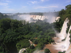 Iguaz Falls (Phillie Casablanca) Tags: travel tree southamerica argentina waterfall adventure waterfalls tropics iguazufalls adventuretravel puertoiguazu roundtheworldtrip cataratasdeliguaz puertoiguaz parquenacionaliguaz