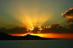 Golden Light (esther**) Tags: lighting light sunset sea sky yellow clouds gold golden bravo colours greece rays topf150 topf100 rhodes beams topf200 interestingness5 magicdonkey specsky bratanesque