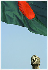 Come Freedom...Come. [..Dhaka, Bangladesh..] (Catch the dream) Tags: blue red portrait sculpture sun green face look freedom 1971 december wind flag bongo free victory independent dhaka independence bengal bangladesh longing bangla bengali tsc victoryday bangladeshi flattering bangali 16december catchthedream gettyimagesbangladeshq2