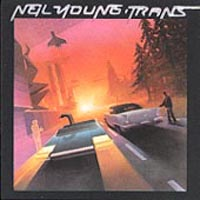 Neil Young - Trans (1982) ... recorded using a vocoder on many songs.  Also with Nils Lofgren or Bruce Springsteen & The E Street Fame.