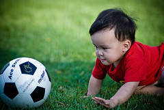 Ace Striker (kktp_) Tags: boy portrait green grass ball children thailand football kid nikon dof child bokeh bangkok soccer determination chubbycheeks 85mmf14d ambitious d80