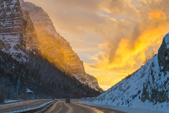 Highway Through Fire and Ice Mountain [Explore] (aaronrhawkins) Tags: provocanyon highway road sunset glow gold fire ice reflection orange utah winter snow canyon walls cloud aaronhawkins twilight evening golden