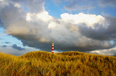 Lights of the land (Danil) Tags: light red sky lighthouse white cold holland netherlands beautiful dutch clouds waddenzee landscape waddeneiland rainbow nikon wind tag d70s nederland noordzee ameland nes breeze vuurtoren buren anything eiland naturesfinest hollum ballum aplusphoto unature endatzijnalledorpjesvanameland
