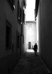 Jana in Borgo (clickykbd) Tags: street city travel people bw italy canon walking person town italia center tuscany clickykbd jana borgo 2007 tuscana bwconverted borgosanlorenzo sd1000 sopahide