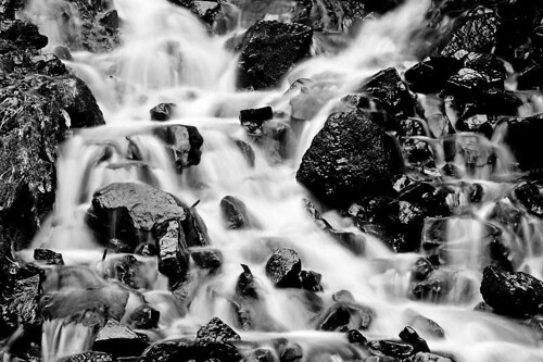 A Trickle Becomes A Flood - water cascading down some rocks at Silver Falls State Park in Oregon