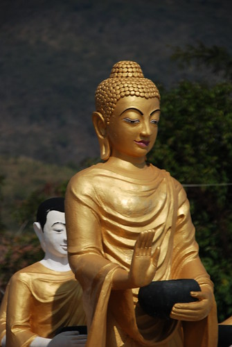 Buddha and monk in Thachilek, Myanmar