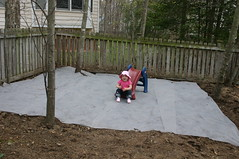 Anna on her new playplace, before it gets mulch