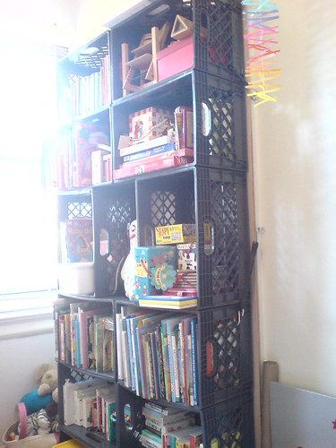 tower of milk crates, zip-tied and strapped to the nursery wall by daddytypes.