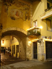 Camaiore's Frescoed Passageways (dsjeffries) Tags: road street bridge building stone architecture buildings painting lights europe apartments doors arch balcony christmaslights archway passage fresco italie stucco passageway wetstreet frescoes camaiore oldpainting wroughtironbalcony camaioretuscany camaioreitaly camaioreitalia camaioretoscana
