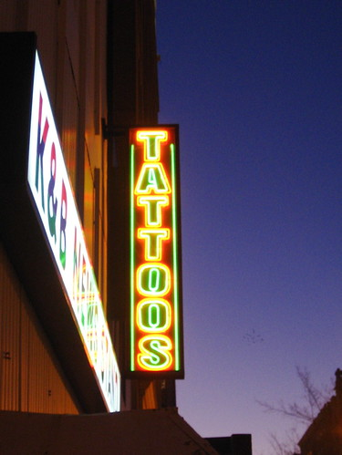 neon tattoo sign. I like the neon TATTOOS sign,