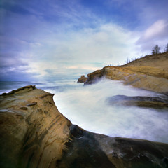 enter the sea, stage right (manyfires) Tags: longexposure sea film beach oregon coast waves pacific shoreline stormy cliffs pacificocean pacificnorthwest zero2000 zeroimage pacificcity capekiwanda palabra pinholebb
