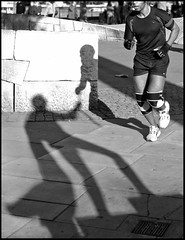 Superhero Relay (ro_nya) Tags: street shadow bw london statue candid running southbank explore superhero jogging runner furtive ronyagalka ronyagalkacom adifferentsortofrelay yahoo:yourpictures=sculptures