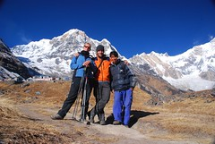 Posing in front of Annapurna South (magical-world) Tags: travel original nepal orange mountain trekking asia bluesky annapurna 2007 worldtrip annapurnas magicalworld verajeanchristophe