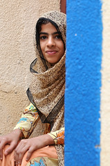 behind the blue  wall (luca.gargano) Tags: voyage africa travel blue girls portrait people girl eyes nikon women chica muslim islam hijab arab chicas niqab exploration oman fille khalid viaggio filles primopiano ragazza wani d300 ragazze bani gargano moza anawesomeshot lucagargano
