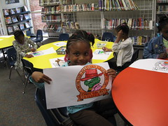 Showing off her art (Huntsville Madison County Public Library) Tags: children libraries coloring thebigread huntsvillemadisoncountypubliclibrary hmcpl chetgeckoparty showerscenterlibrary