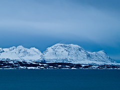 Winter mountains (jungl thomas) Tags: ocean winter sea sky mountain snow norway clouds norge wind norwegen olympus arctic noruega nordic polar scandinavia nordnorge norvge e500 ibestad grytya andrja