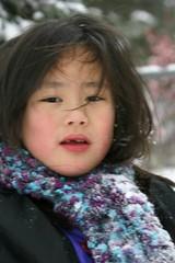Sophia During the First Snowfall on 12-2-07 (Pictures by Ann) Tags: china blue black scarf purple handmade crochet snowfall rosycheeks adoption firstsnowfall crochetedscarf womanmade internationaladoption