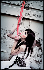 (evil waffles) Tags: pink blue red portrait white selfportrait black girl fashion digital self canon hair lens photography 350d rebel xt eyes dress makeup location photograph ribbon 1855mm onlocation