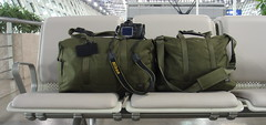 Companions (Johnny Vulkan) Tags: china travel green bag airport nikon packing luggage canvas porter monocle pvg d80