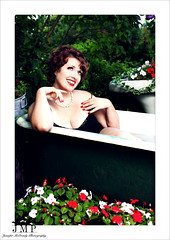 Pondering Life (Jennifer McCready Photography/Lady Luck Pin Ups) Tags: red portrait blackandwhite woman ontario canada cute closeup fun model lips tub redlips 50s dork jordon baillie jennifermccreadyphotography styledwithkare toxxicrainbowcostmetics