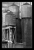 Towers (skinr) Tags: wood nyc newyorkcity urban blackandwhite bw rooftop industrial manhattan grunge bricks pipes plumbing gray clean textures watertowers oldandnew wwwjskinnerphotocom