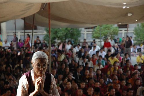 Tibetan woman prays at the front of the crowd, Sakya Lamdre, Tharlam Courtyard, Kathmandu, Nepal by Wonderlane