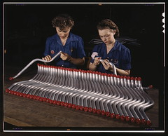 "Two women workers are shown capping and inspecting tubing which goes into the manufacture of the ""Vengeance"" (A-31) dive bomber made at Vultee's Nashville division, Tennessee. The ""Vengeance"" (A-31) was originally designed for the French. It was later ado (The Library of Congress) Tags: woman industry vintage airplane women war nashville tennessee parts aviation military wwii airplanes pipes tubes dive slidefilm worldwarii 1940s transparency ww2 4x5 lf libraryofcongress uniforms february bomber tubing largeformat worldwar2 1943 assembly a31 wartime transparencies capping vengeance manufacturing nashvilletn divebomber workforce womenworking vultee historicalphotographs february1943 davidsoncounty wareffort xmlns:dc=httppurlorgdcelements11 dc:identifier=httphdllocgovlocpnpfsac1a35376 alfredtpalmer vulteeaircraftincorporated alfredpalmer divebomberassembly vulteeaircraftcorporation vulteeaircraft vulteevengeance bombermanufacturing"