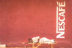 Niamey, Niger (gstads) Tags: niamey niger coffee nescafe nap sleeping red africa sahel nescafé sleep afrique street streetscene streetphotography african africain westafrica afriquedelouest