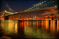 New York City (Moniza*) Tags: city nyc longexposure bridge sky ny newyork reflection water skyline brooklyn night clouds skyscraper river geotagged bravo downtown cityscape manhattan dumbo illumination brooklynheights midtown nightlight esb brooklynbridge manhattanbridge eastriver empirestatebuilding gothamist bluehour fultonferry gothamcity thebigapple lightstream moniza exhibitionoftalent masterclassexhibition