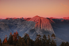 Smoky Sunset on Half-Dome (Tyler Westcott) Tags: california sunset smoke halfdome yosemitenationalpark alpenglow sentineldome penumbra mountainlight nikond40 penumbrallight
