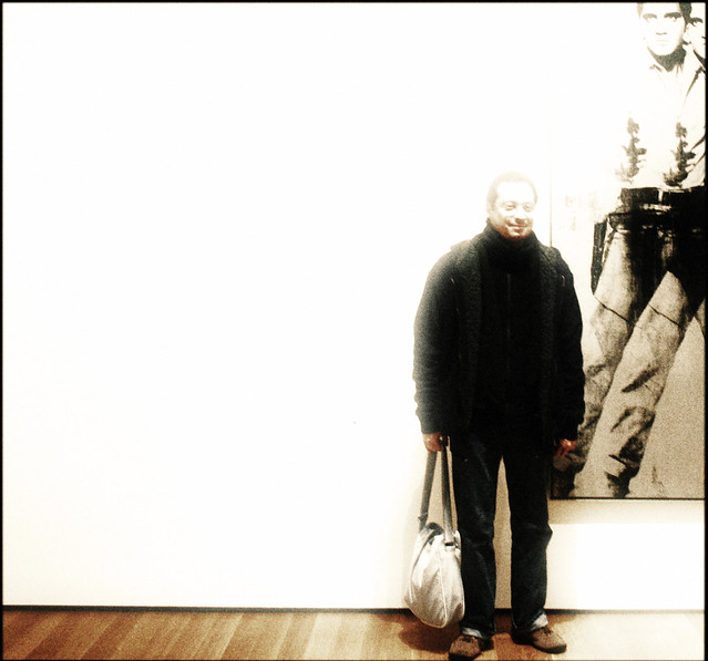 Man with Warhol's Elvis at MoMA, 2007