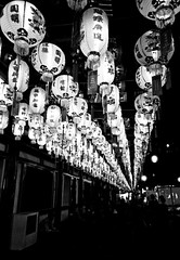 B&W Lanterns (GenkiGenki) Tags: light blackandwhite bw film night temple mono singapore chinatown 28mm delta gr lantern ilford ricoh gr1v delta400 buddhatoothrelictemple