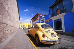 The yellow Beetle (LucaPicciau) Tags: road urban peru southamerica architecture vw america volkswagen strada colours beetle perù giallo caterina colori maggiolone arequipa yallow città ande caldo marciapiede pomeriggio lupi maggiolino picciau lucapicciau amsrillo