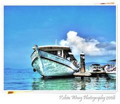 Kota Kinabalu Marina~  (Kelvin Wong (Away)) Tags: travel blue sea reflection water clouds marina boat malaysia borneo kotakinabalu sabah aplusphoto favemegroup7 kelvinwong piscesromance malaysiatrip2008