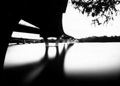 Pedestrian bridge pinhole (spiffytumbleweed) Tags: bridge bw austin texas pinhole papernegative townlake allrightsreserved copyrighted homemadecamera ladybirdlake copyrightedallrightsreserved