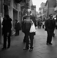 Street reading (lumiereparken) Tags: street bw italy rolleiflex reader trix taormina sicilia 28f
