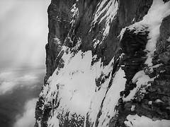 eiger north face  traverse of the gods (chris frick) Tags: light sky mountains alps ice nature face rock vertical horizontal museum sepia fun high amazing view space vacuum deep atmosphere traverse rope adventure climbing exposition alpine limestone climber process northface eiger shining depth impression breathtaking icefield ambiance alpinism postprocessing eigernordwand moutaineering bernesealps naturalhigh alpinestyle eigernorthface chrisfrick traverseofthegods rogerschaeli