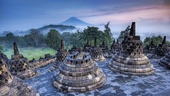 The Hidden Buddhist Temple of Borobudur at Sunrise (Stuck in Customs) Tags: pictures morning travel sunset panorama mist beautiful lines fog composition sunrise work indonesia landscape temple photography volcano java ancient nikon colorful meditate shoot photographer shot angle photos stupa buddhist secret details religion pray perspective images adventure hidden jakarta edge processing pro chorten top100 bara capture hdr tutorial borobudur trey treatment boro chedi tope discovered highquality travelphotography budur borabudur borobodor hdrtutorial stuckincustoms barabudur treyratcliff jagjakarta barobudur burobudur stpa dgaba thpa