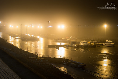 Winter harbour during the foggy night...