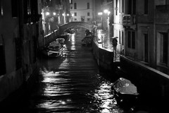 Pioggia Nera (Black Rain), Venice (flatworldsedge) Tags: venice white black lamp rain night umbrella canal shadows bn gas rainy