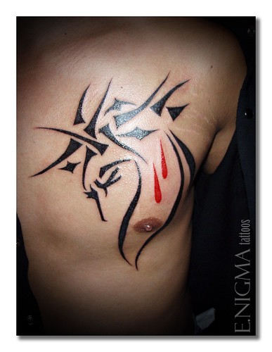 It is a Filipino Tribal tattoo with USMC Semper Fidelis incorporated in the
