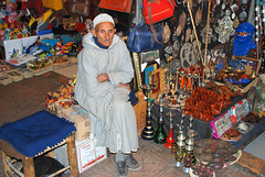 Bedouin merchant (Liv ) Tags: africa street travel blue light sunset red 2 people 3 man sahara colors tag3 night square 1 photo tag2 colours tag1 market minaret tag ivan hijab rosa el mosque unesco morocco 09 maroc marocco marrakech souk medina afrika 2008 marruecos rosso colori ghetto occidentale souq 08 koutoubia afrique fna lazzari mosquita jemaa marocchino  djemaa laiv   nikond80 aplusphoto laivphoto  130108 marrki   313807n80001w316352788000278coordinate313807n80001w316352788000278