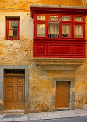Red Balcony (albireo 2006) Tags: door old red window yellow architecture facade balcony vivid malta dilapidated valletta 5photosaday v18 travelon5photosaday theenchantedcarousel valletta2018