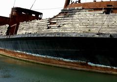 sidewall (normaltoilet/ LSImages) Tags: ontario canada water bay boat wooden nikon rust ship floating shipwreck lakeontario wreck burned d40 jordanstation