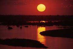 Okavango River Sunset (Peter Schnurman) Tags: africa sunset namibia angola kavangoriver