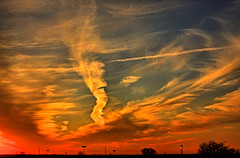 MidWestern Serenade (FotoEdge) Tags: light sunset red orange sun storm colors yellow clouds contrast rural dark glow warmth farmland mo jetstream missouri oranges burst yellows streaks reds explode serenade overwhelmed claycounty fotoedge seasonalchange skyexplosion midwesternserenade