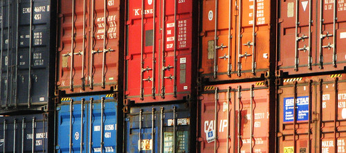 shipping containers stacked in rows, filling the frame