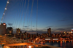 Brooklyn bridge in the night along with ny skyline