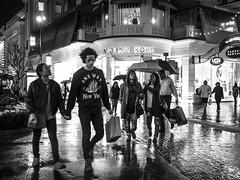 Night at the Grove (tritranla) Tags: losangeles people streetphotography urban rain candid